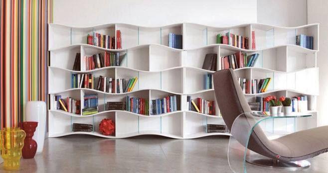 Домашняя библиотека будет отлично гармонировать с интерьером помещения, ведь главное в ней - это удобное кресло, хорошее освещение и стеллаж с книгами. Такие книжные стеллажи с полками-ячейками разной формы выполненные в различных стилях и цвете могут украшать рабочий кабинет, гостиную, детскую комнату. Удобно, просто и стильно. Хотите, чтобы и ваш дом выглядел неповторимо? Дизайнеры компании Feronia помогут создать дизайн проекты интерьера вашего дома и учесть все ваши пожелания.