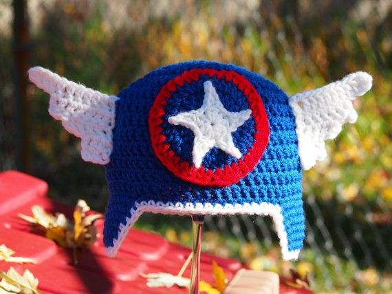 This Captain America hat is perfect for you little man, who loves Marvel comics.    Braids can be added to the ear flaps      Sizing:  Newborn  0-3