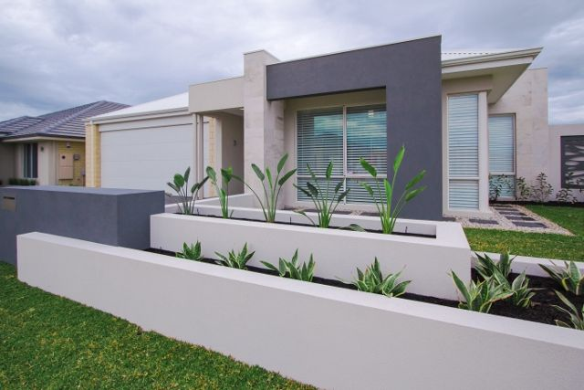 This stone finish is offset by the painted sand finish render in contrasting Dulux colours of Malay and Pebble Grey, and by the feature planter boxes and composite wood-look decking (in Clam Shell).