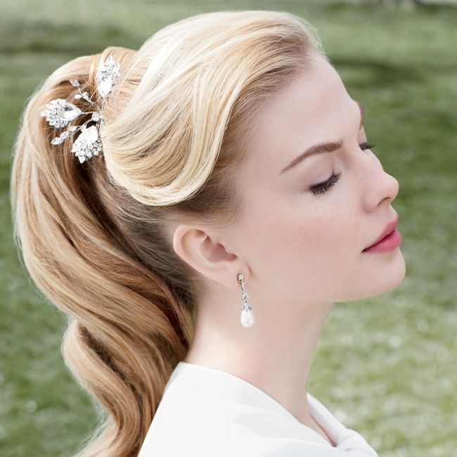 60's inspired sleek high pony tale with light curl // Photographer: Abbey Drucker // Hairpin: Erin Cole // Earrings: Carolee