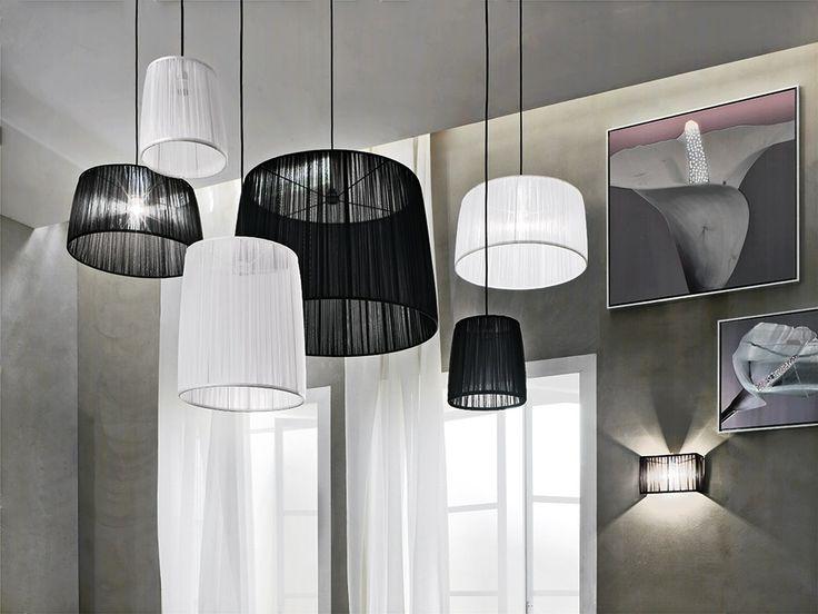 > Dimensions: Ø 20/25 H. 25, Ø 45/50 H. 25, Ø 50/60 H. 30, Ø 35/40 H. 45, Ø 75/90 H. 60 > Materials: Organza Fabric > Colours: White, Black