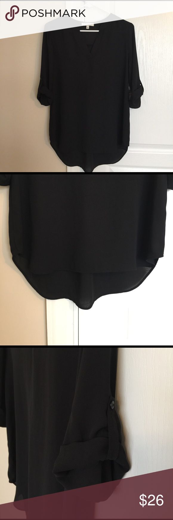 NWT Chaus 3/4 Roll Sleeve Black Tunic NWT Chaus 3/4 Roll Sleeve Black Tunic. Split neck Tunic with rolled sleeves and high/low hem, semi sheer.  Pairs great with skinny jeans or leggings Chaus Tops Tunics