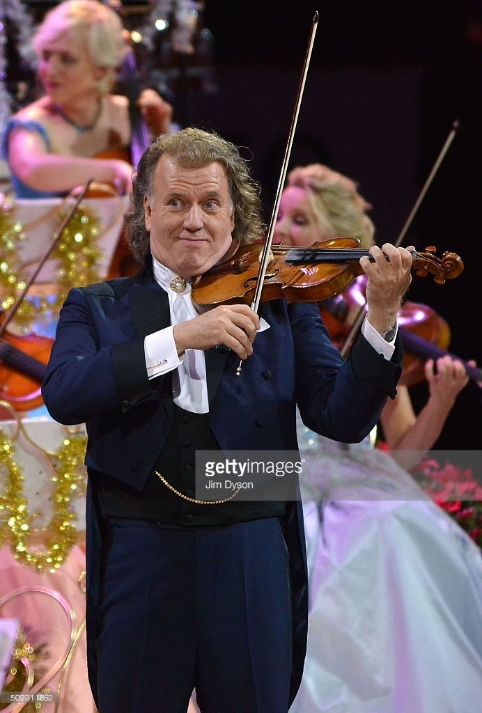 Dutch violinist and conductor Andre Rieu performs with the Johann Strauss Orchestra at Wembley Arena on December 22, 2015 in London, England.
