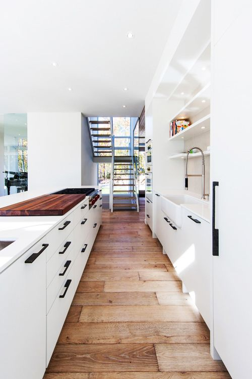 Great floor with clean white and like black handles.