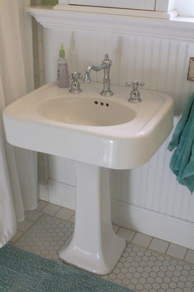 Pedestal sink with wainscotting--such a clean, old ...