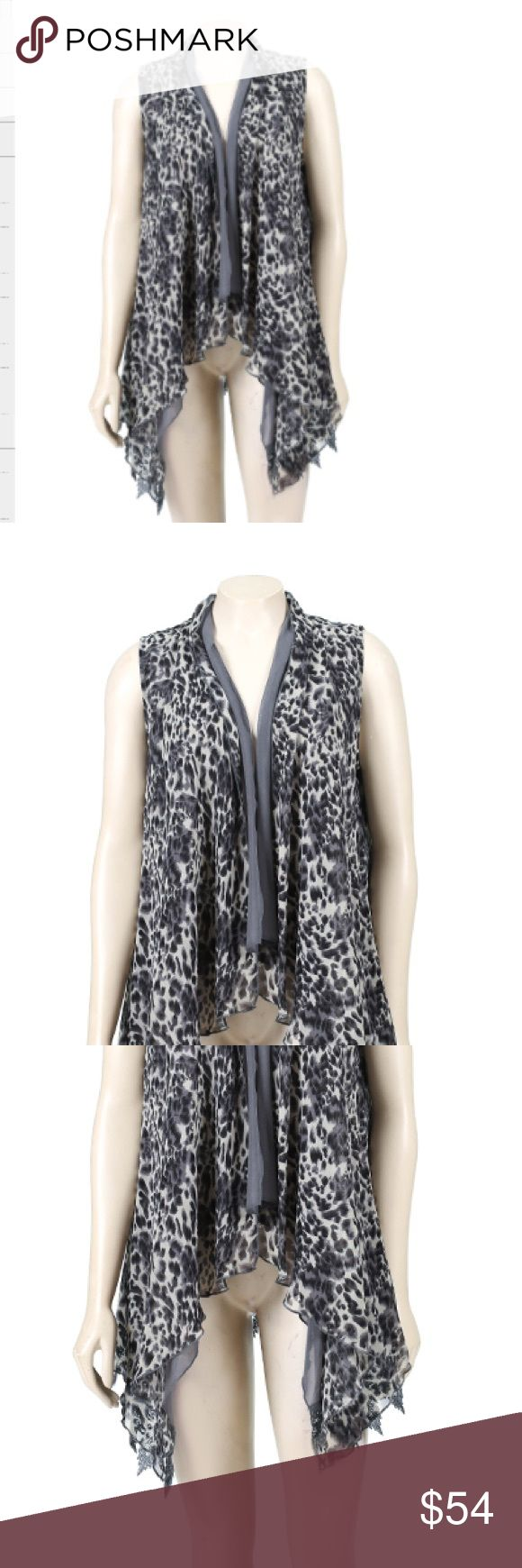 Layered Leopard Print Vest in Grey VERY Versatile Leopard Print Grey Vest              100% Polyester                                                     Layered Vest                                                      Longer in the front                                            (Sorry for the crotch shot!)                                    Every purchase comes with free gift!!  Let me tag you so you can choose the color Jackets & Coats Vests