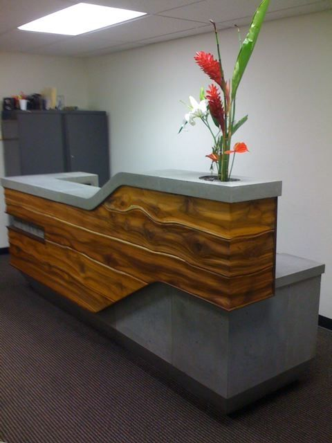 sculptural reception desk, with sculpture instead of plant on the end