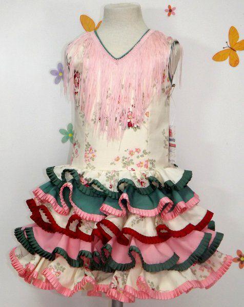 Traje de gitana para niña beige estampado con flores y adornado con volantes de varios colores. Posibilidad de añadir o quitar flecos a juego por el mismo precio. Puedes encontrarlo en nuestra tienda online http://www.mibebesito.es/trajes-gitana-flamenca-realizados-a-mano-nina/gtn136