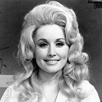 Dolly Parton,1972, The rising star (who released two solo albums and performed with partner Porter Wagoner) had already adopted her trademark whipped cream wigs and frosty makeup.