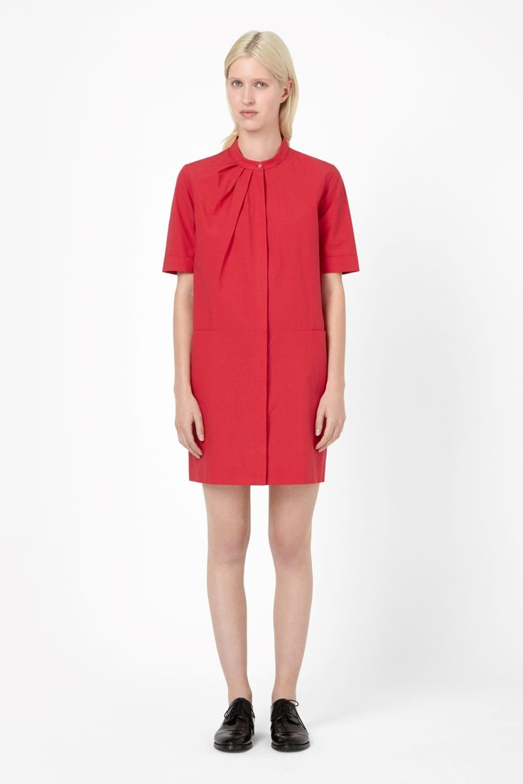 Made from crisp cotton poplin, this lightweight shirt dress has a standing collar and softly pleated neckline. A straight shape with a dropped waistline for a relaxed silhouette, this versatile style has crisp folded cuffs, hidden button fastening and deep side pockets.