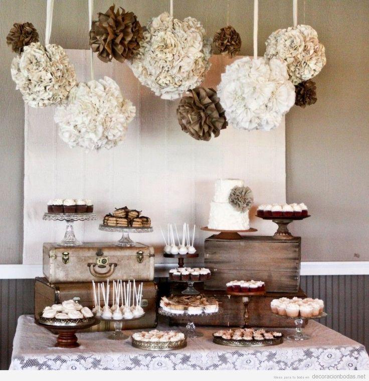 Decoración de mesa de postres de una boda estilo vintage