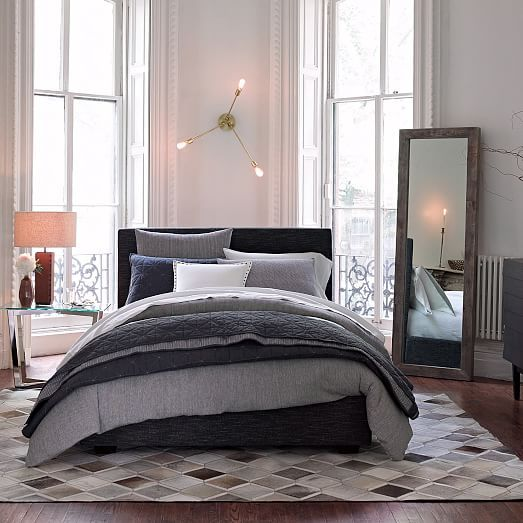 Bedroom: blues, grays and whites with glass and bright metal accents
