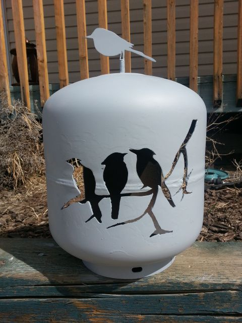Here is another bird feeder I made out of a 20 lbs propane tank for another good friend.  I cut it out along with the tank topper (that's what I call it) with my plasma cutter.  I welded the tank topper on, applied a coat of primer so she can paint it any colour she wants.
