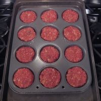 Use your regular recipe and -Preheat oven to 375 degrees. Spray muffin pan with non-stick cooking spray. Form meat mixture into individual medium sized balls & drop into each muffin tin. Bake 30 minutes. Spread each mini loaf with ketchup and bake an additional 10 minutes or until they're cooked through (160 degree)