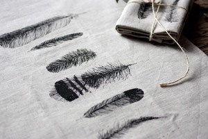 Feather patterns pressed onto fabric