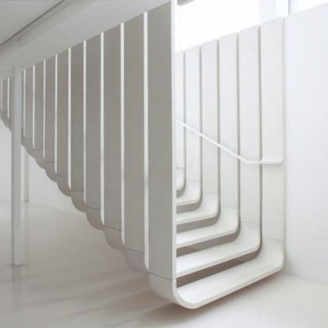 VERTICAL LINE: DEF: Makes space appear taller WHY: Secluded, plain, no emotion, tall walls surrounding the stairs