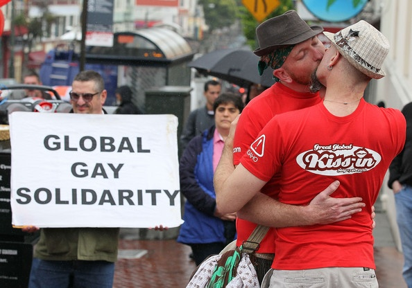 """Same-sex couple J. Inness (L) and Drew Staffen kiss in front of the Castro Theatre during a """"Kiss-In"""" to recognize the International Day Against Homophobia May 17, 2010 in San Francisco, California. A half dozen same-sex couples kissed in solidarity with groups around the world who staged """"kiss-ins"""" for the International Day Against Homophobia, which raises awareness to end harmful and discriminating acts against gays, lesbians and transgendered."""