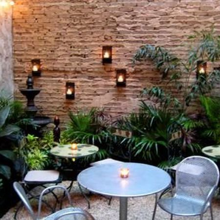 Small courtyard garden with seating area design and layout 18
