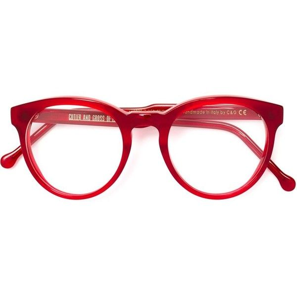 Red acetate round frame glasses from Cutler & Gross. This item comes with a protective case. This item is unisex.