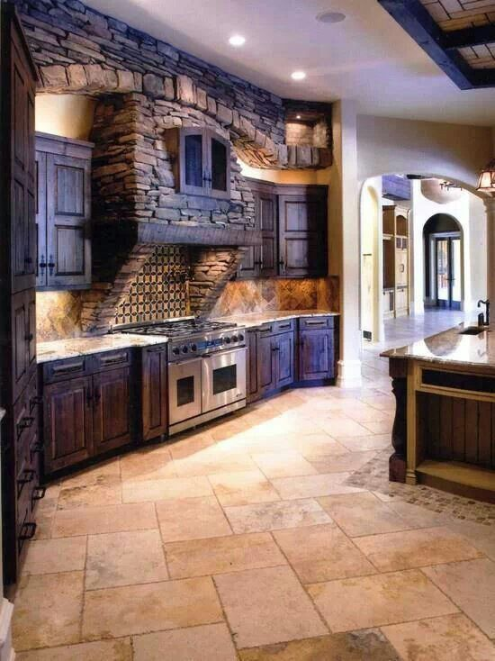Dream kitchen! I love the exposed stone, rustic cabinets, infinite amount of counter space, giant gas stove and ovens...