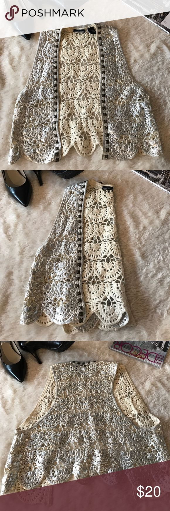 Moda International Crochet Silver Vest Like new moda international crochet silver vest.  Vest has stunning silver color with studded bead work along the trim. Vest measures approx 18inches long. Pit to pit measures approx 17inches wide. Moda International Jackets & Coats Vests