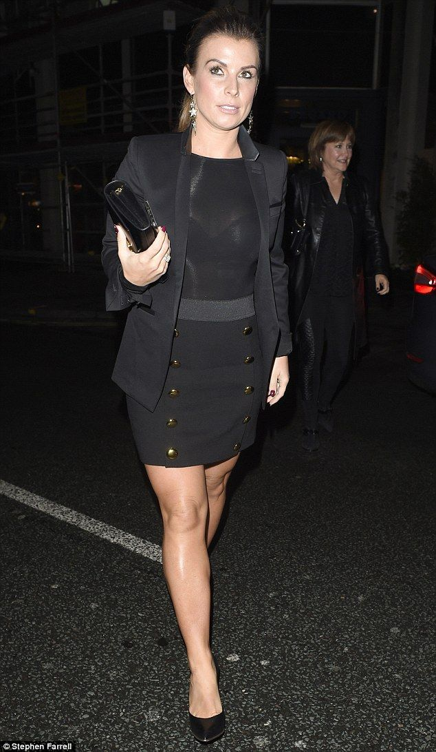 Chic: Coleen Rooney, 30,did not fail to look glamorous in a chic black military skirt and blazer as she headed to the opening of the new Neighbourhood  Restaurant in Liverpool on Thursday