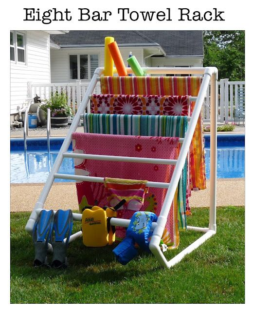 PVC Pool Towel Rack! So much better than covering the entire deck and furniture in wet towels!