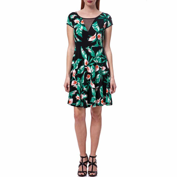 Μίνι φόρεμα με κοντά μανίκια σε μαύρο χρώμα, με σχέδια κατά μήκος του στις αποχρώσεις του πράσινου και του ροζ. Η ημιδιαφάνεια στο πανω μέρος προσθέτει ακόμη περισσότερο στιλ.