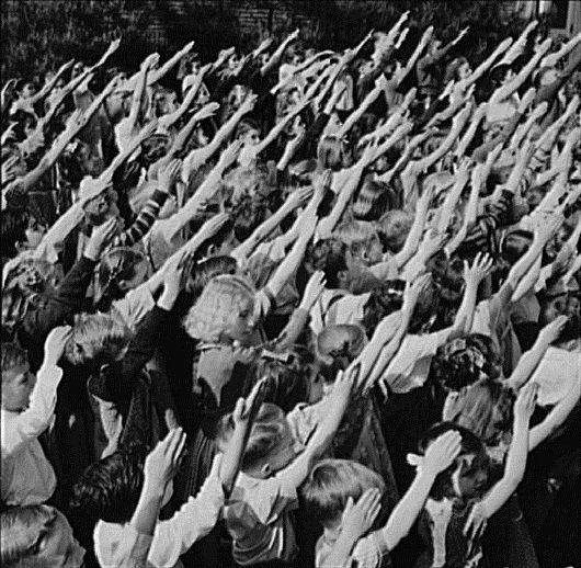 """Bellamy Salute 2""""The Bellamy salute, first demonstrated on October 12, 1892, was described by Francis Bellamy to accompany the American Pledge of Allegiance, which he had authored.   """"When Italian fascists and Nazis adopted a similar salute, it was officially replaced by the hand-over-heart salute when Congress amended the Flag Code on December 22, 1942."""""""