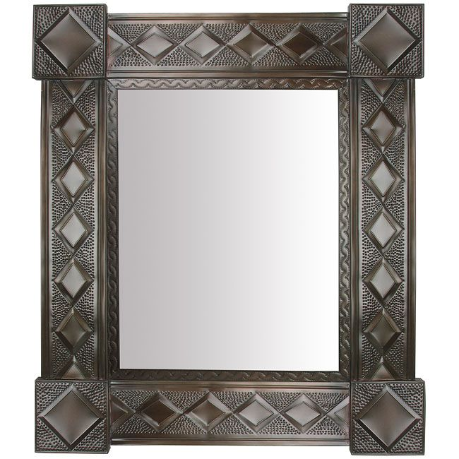 """Our Mexican aged tin wall mirrors are the perfect remedy for a boring wall in your rustic, southwest, or Spanish colonial style home. This unique Mexican mirror is all hand punched, cut, and etched by tin artisans in Mexico. Measures: 29"""" x 25"""""""
