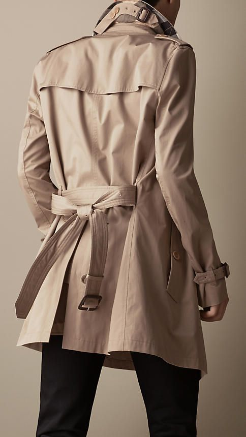 Burberry Taupe Cotton Twill Trench Coat - A showerproof trench coat made from lightweight cotton twill. A Kensington modern fit, the trench coat is tailored to the body with slim set-in sleeves. Heritage details include epaulettes, storm shield and belted cuffs. The coat is complete with a check under collar. Discover the men's outerwear collection at Burberry.com
