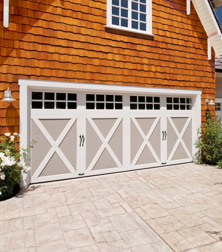 Make your home stand out with carriage-house garage doors. It's an update that adds curb appeal and distinctive detail to your home. We love this traditional look from the Coachman Collection of garage doors by Clopay. These complement many architectural styles including Craftsman, Shaker, Traditional, French Country, Tudor and Victorian.
