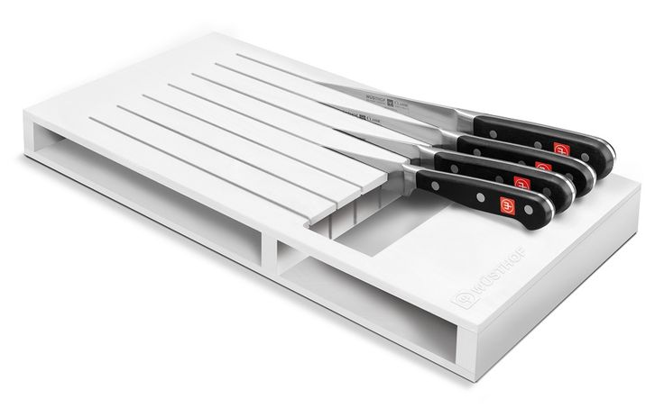 Stylish and functional drawer insert made from easy-care clean white plastic. For 7 knives with a blade length of up to 23 cm.