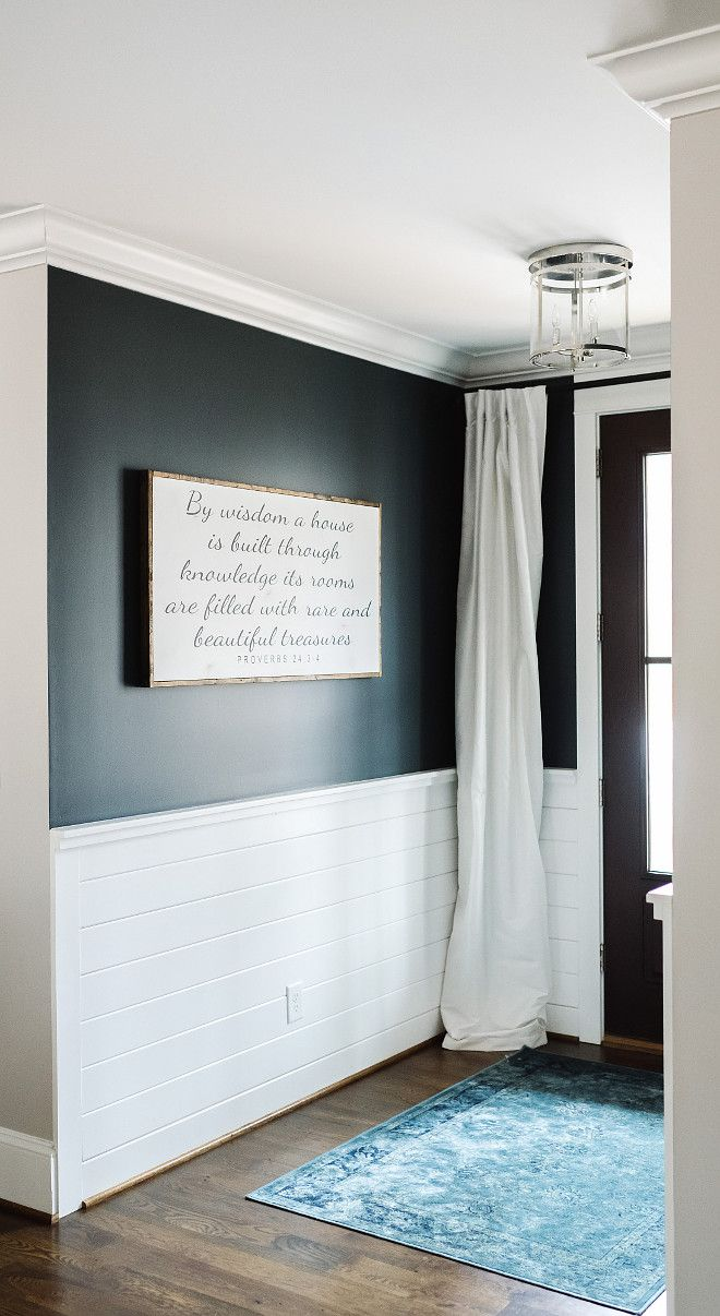 The wall paint color is Mount Etna SW7625 Sherwin Williams. Paneling is Sherwin Williams Snowbound.  Interior Door Paint: Black Fox by Sherwin Williams.