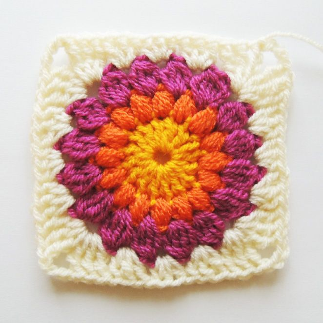 Nittybits: Sunburst Granny Square Blanket Tutorial- and then when the basic granny square is mastered I will be attempting this beauty.  I love these colors!