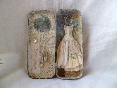 by Messie Jessie / assemblage -altered tin with paper dress. by glenda
