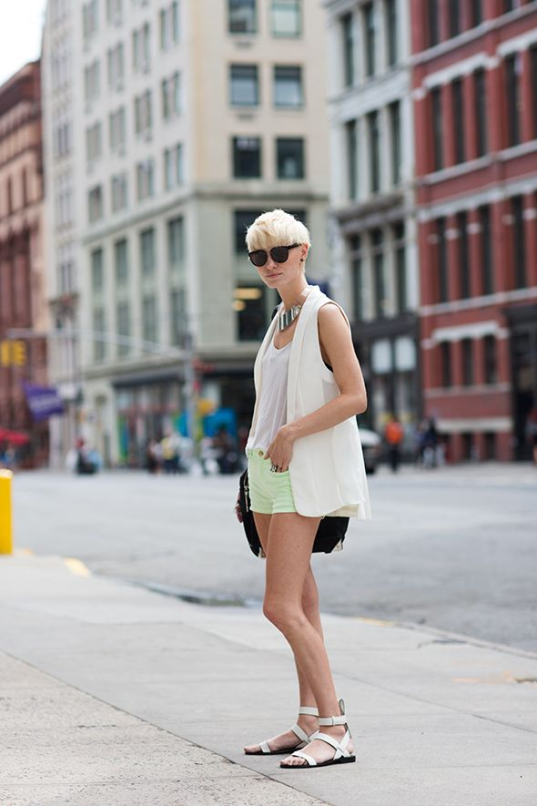 On the Street…..Lafayette St., New York. The Sartorialist. Blonde girl with short hair, mint green shorts, silver metallic sandals