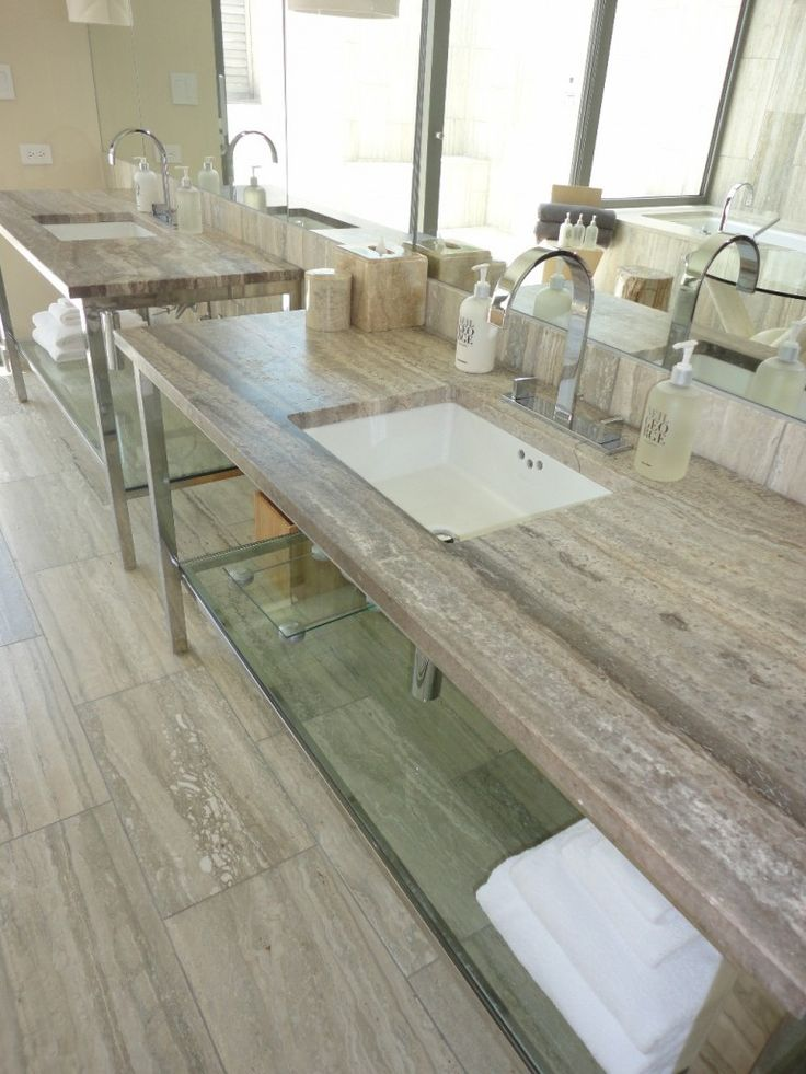 travertine countertops, I definatly wouldn't dop the floor the same colour as the countertops, maybe something dark to contrast the light
