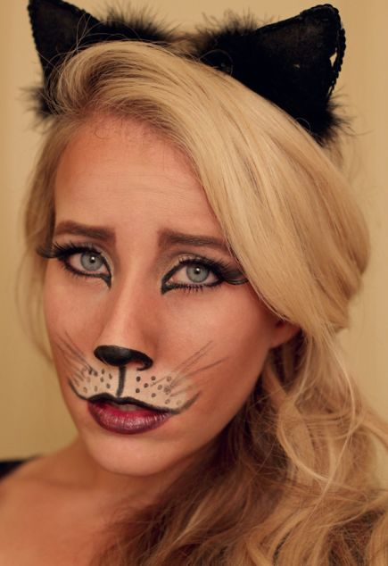 A dramatic cat-eye and filled and shaped brows give this kitty makeup a soulful look. #halloween #cat #costume