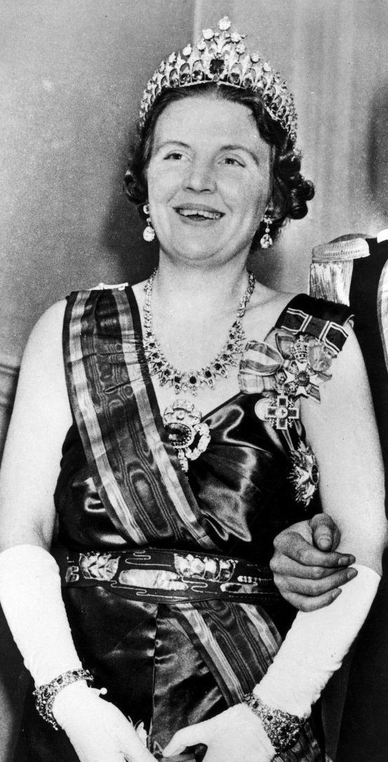 HM Queen Juliana of the Netherlands wearing the complete Dutch sapphire parure (the necklace has recently been converted on a tiara), a pair of diamond earrings and various orders.