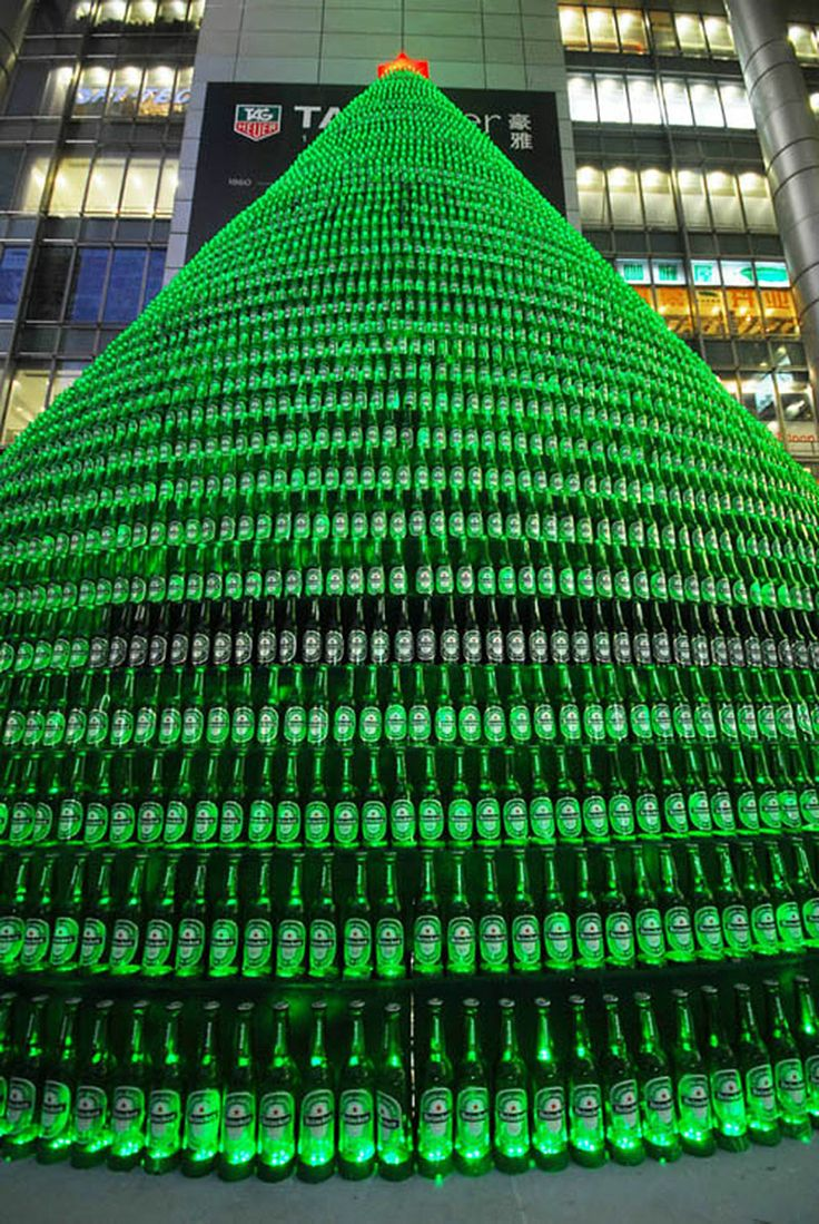 Christmas Tree made from 1000 Heineken Bottles. One of Five of The Most Spectacular and Unusual Christmas Trees From All Over The World. See all at http://ifitshipitshere.blogspot.com/2012/12/from-pac-man-to-porcelain-five-most.html