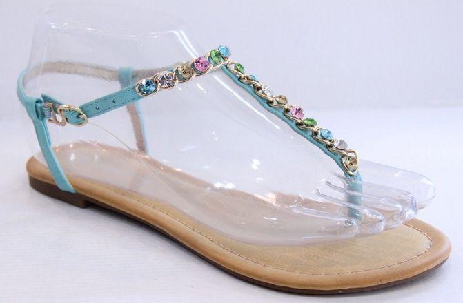 Blauwe sandalen met gekleurde steentjes Leuke blauwe (Ibiza style) sandalen met gekleurde steentjes, voorzien van een gespje.  Verkrijgbaar in de maten 36 - 41.     (let op: de slipper valt kleiner uit, heb je bijvoorbeeld maat 38, dan kun je beter maat 39 nemen)