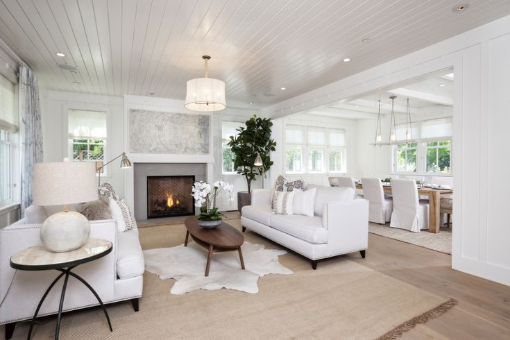 A fireplace anchors the living room.