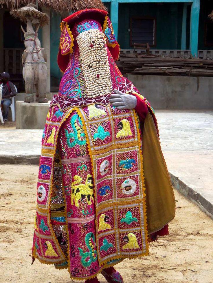 A voodoo dancer displays his exotic cape at Ganvie village on Lake Nokoue, near Cotonou, Benin.