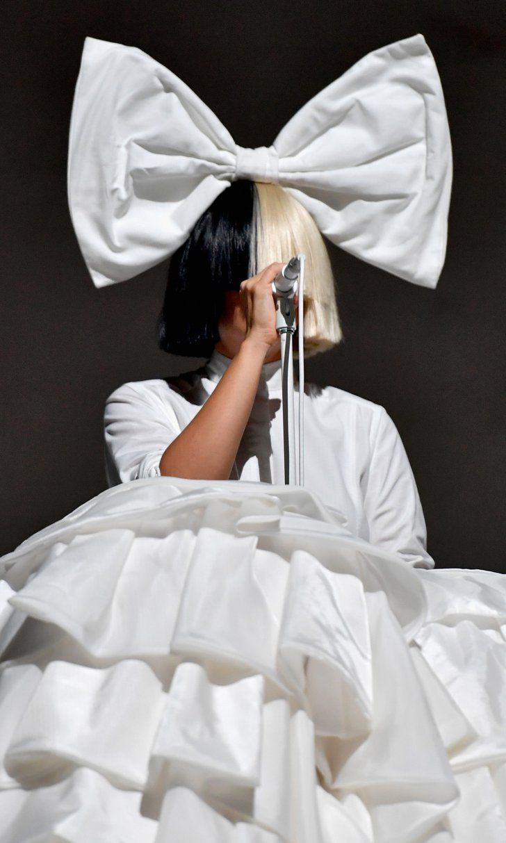 Wondering Why Sia Covers Her Face While Performing?