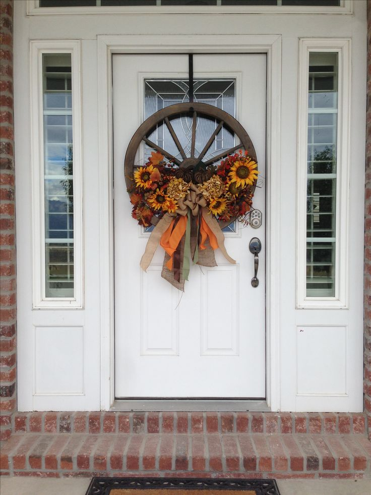 This is my Fall Wreath 2013. Wagon Wheel and silk flowers.