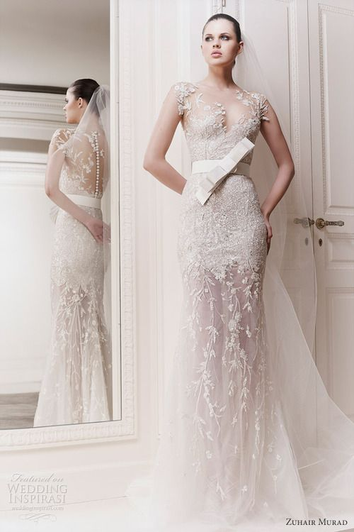 Zuhair Murad sheer wedding dress - The bow looks stupid, and I'm not sure about the way the hip region is done, but I like the bottom and the top.