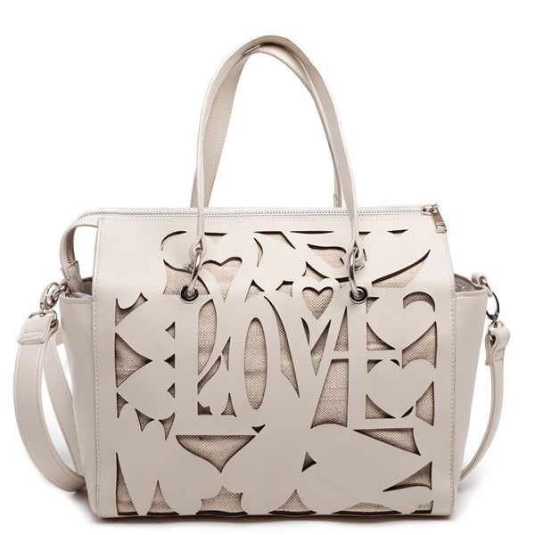 Creme bag with laser-cut LOVE design and textile.