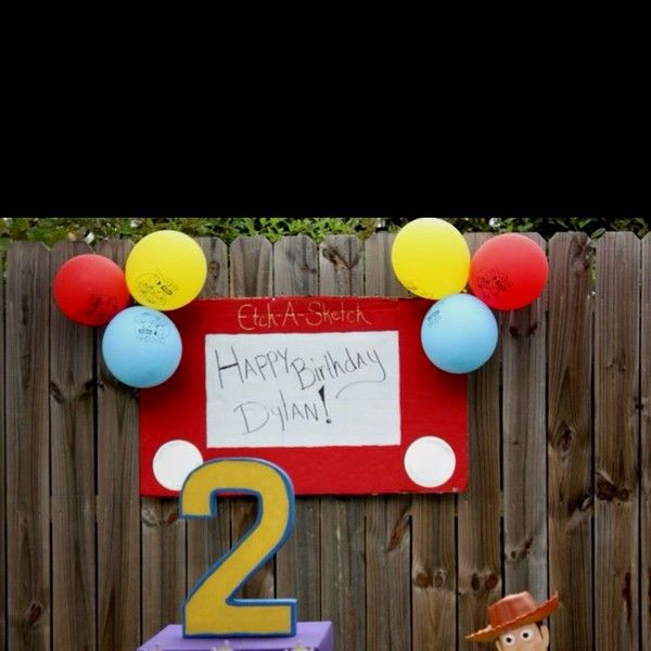 This is SUCH a cute idea!!!! Homemade cardboard Etch-A-Sketch sign for toy story party