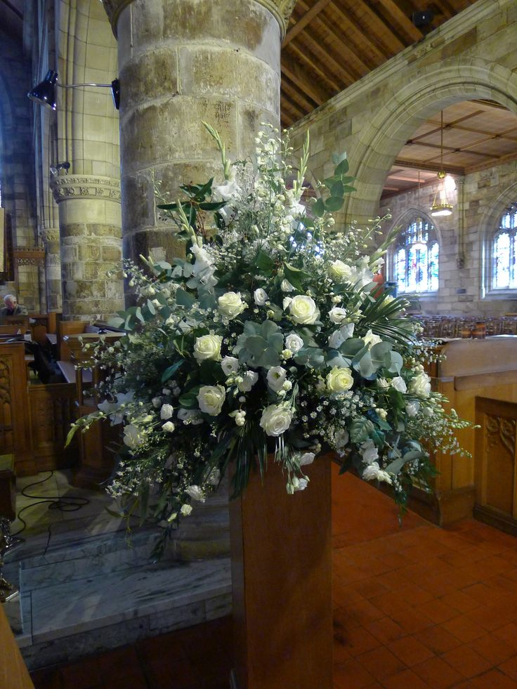 A 5ft pedestal made for St. Trinity Church in St. Andrews.  Made up of whites, creams and greens, I used white delphinium, white gladioli, white september flower, white eustoma, white avalanche roses and cinerea eucalyptus.